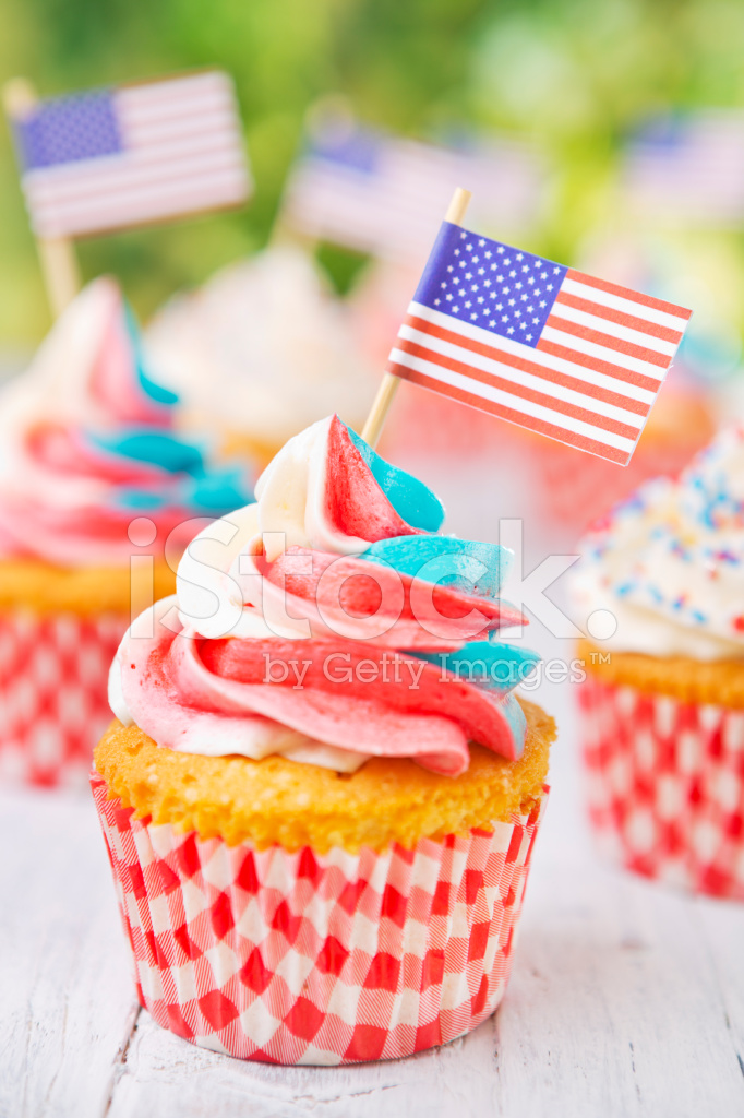 3158dc3f08a Cupcakes With Red White and Blue Frosting and American Flags on ...