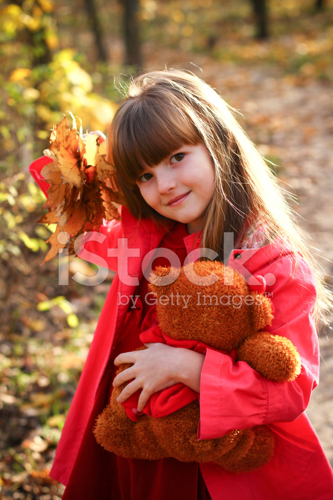 Little Girl With Maple Leaves And Teddy Bear Stock Photos Freeimages Com