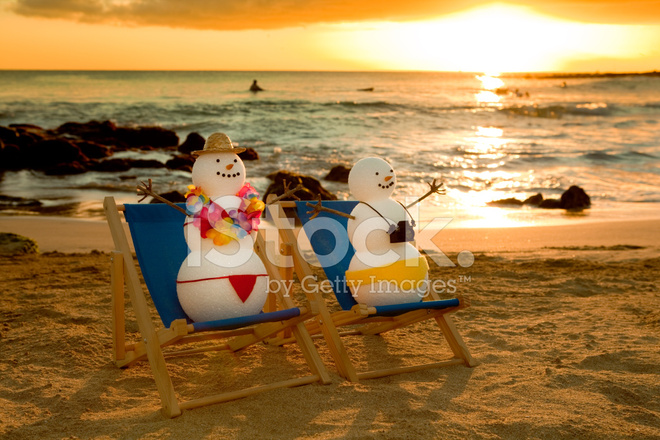 Snowman Couple On Winter Vacation In Tropical Paradise