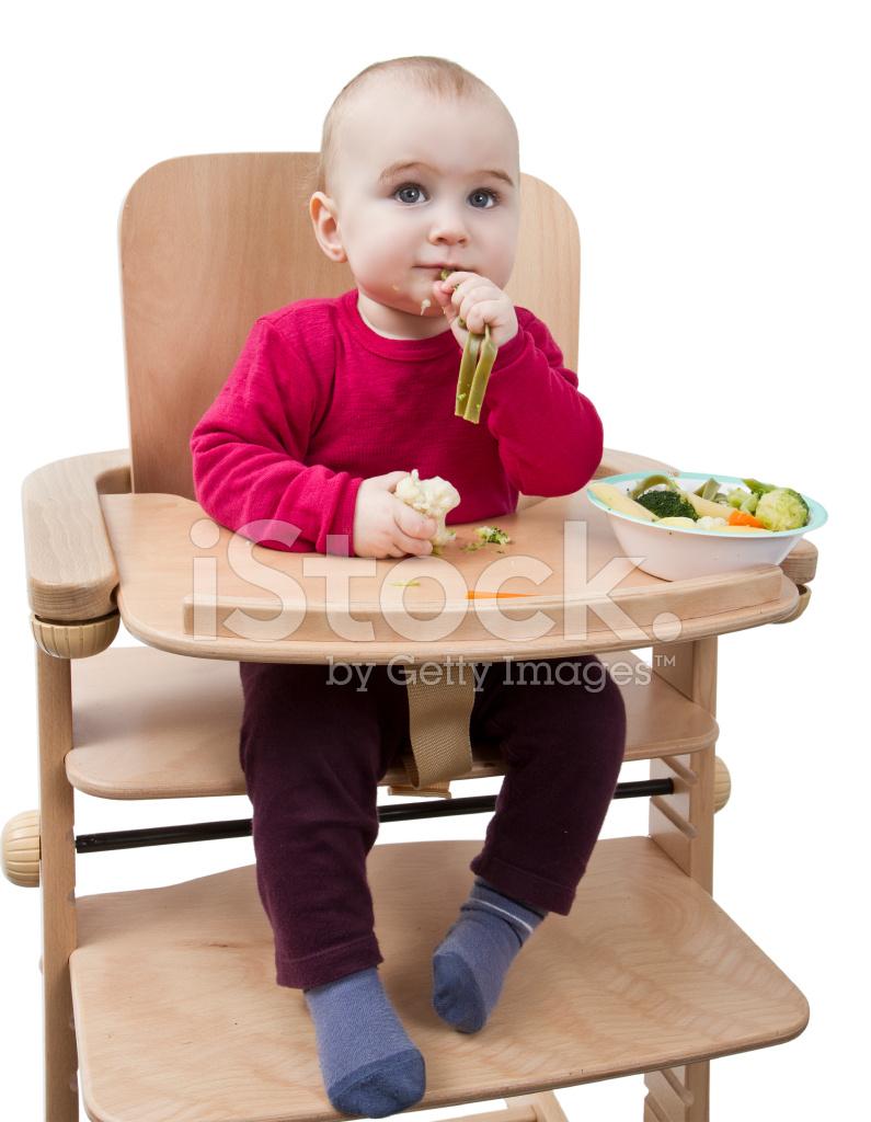 Hoge Stoel Kind.Jong Kind Eten In Hoge Stoel Stockfoto S Freeimages Com