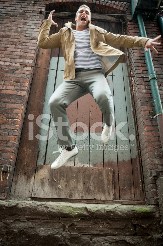 Young Man Jumping Off A Building Stock Photos Freeimages Com