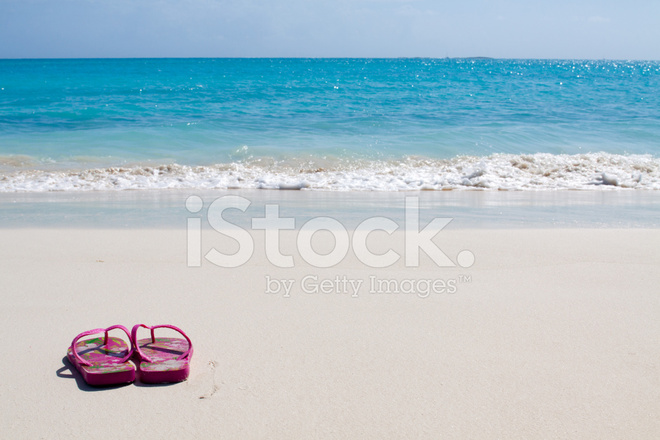 936d94553 Pair of Colored Sandals on A White Sand Beach Stock Photos ...