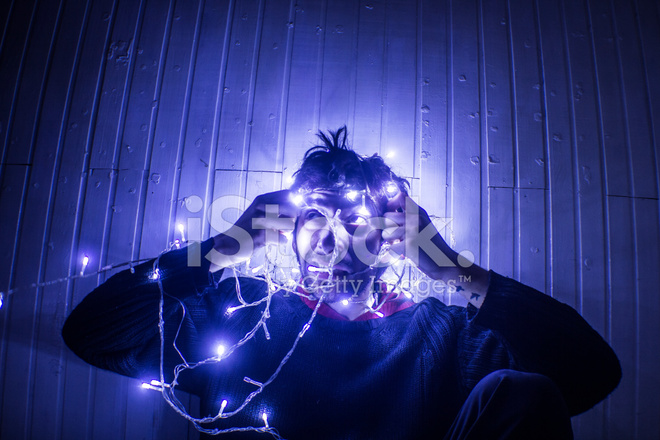 Premium Stock Photo Of Young Man Trying TO Untangle Christmas Lights IN Dark Room