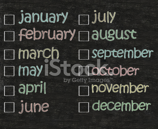 monthly calendar written on blackboard background high resoluti