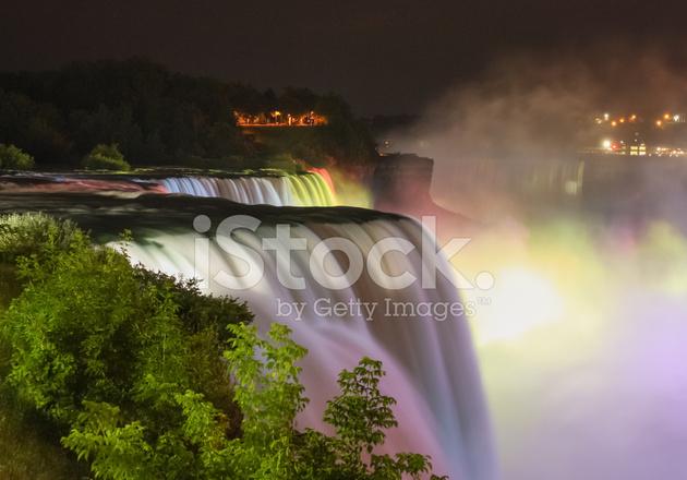Niagara Falls Illuminated By Colorful Lights Stock Photos