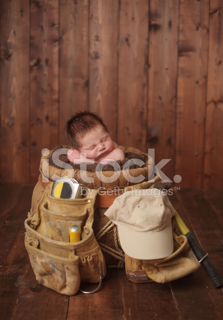 Newborn Baby Sleeping In A Basket With Grandfather S Tool