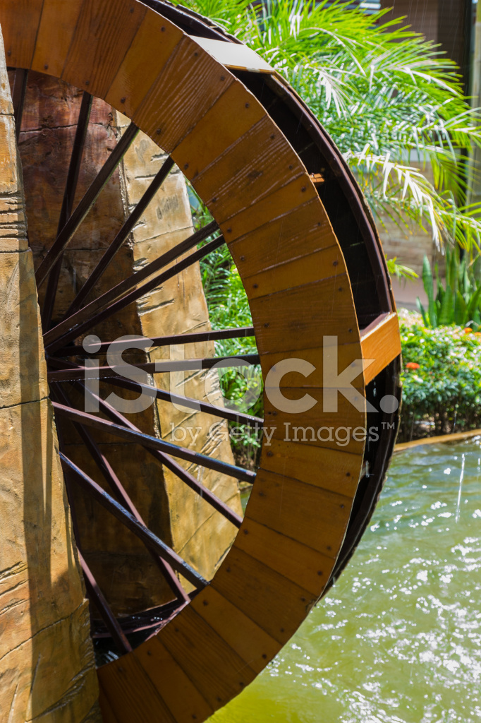 Decorative Water Wheel In The Garden, Element Of Modern