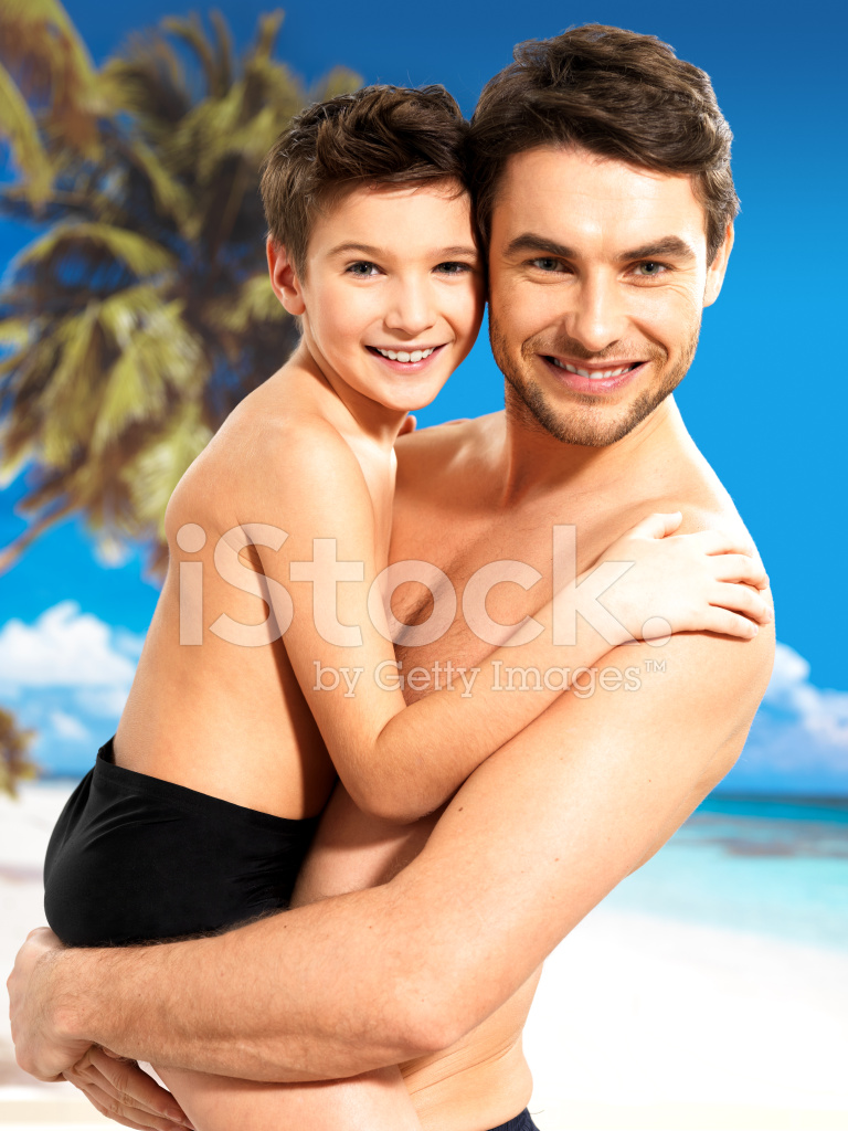 father and son naked on beach