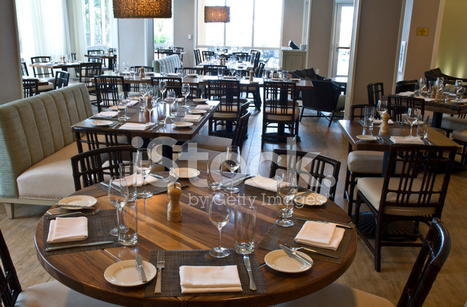 Elegant restaurant interior tables and place settings