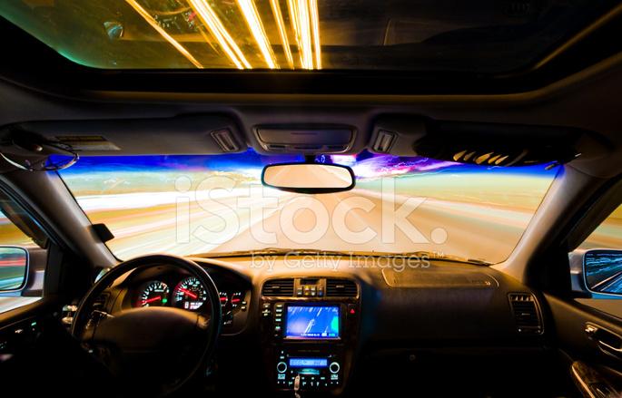 Car Speeding On Las Vegas Boulevard At Night Long