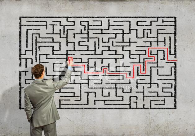 Businessman Solving Labyrinth Problem Stock Photos - FreeImages com