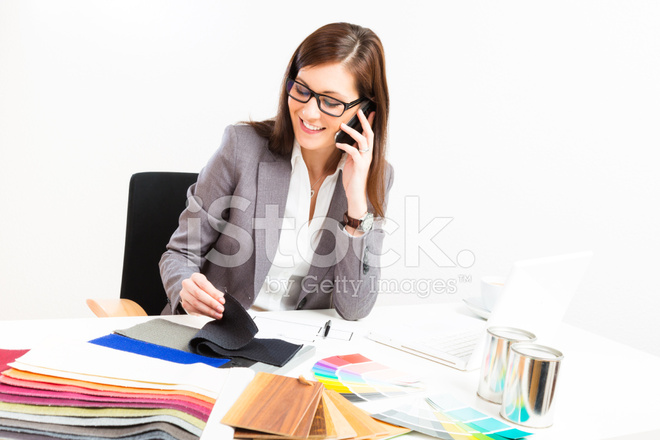 Female Interior Designer At Her Desk Stock Photos