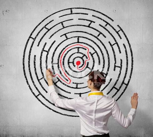 Businesswoman Solving Maze Problem Stock Photos - FreeImages com