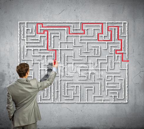 Businessman Solving Labyrinth Problem Stock Photos