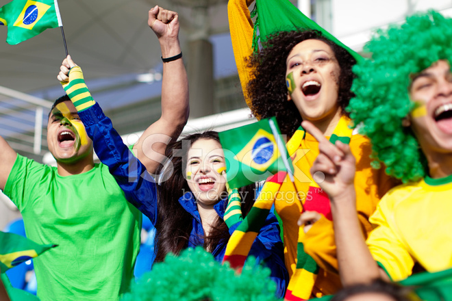 Group Of Fans Cheering For Brazil During A Football Stock Photos