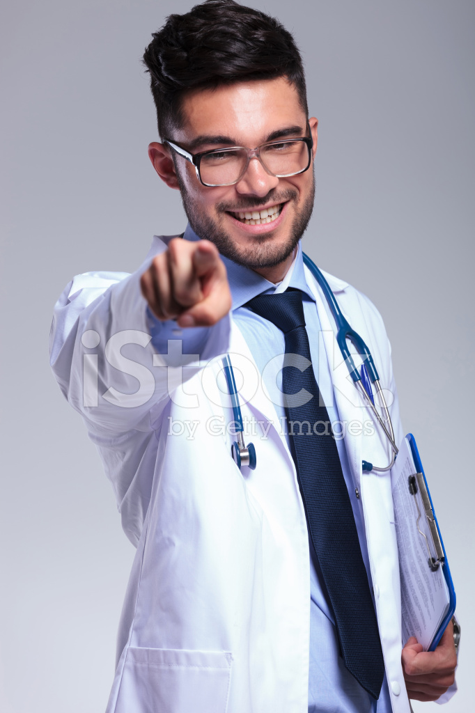 Young Doctor With Clipboard Pointing At You Stock Photos