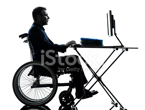 handicapped business man puting laptop puter in wheelchai  handicapped business man puting laptop puter in wheelchai