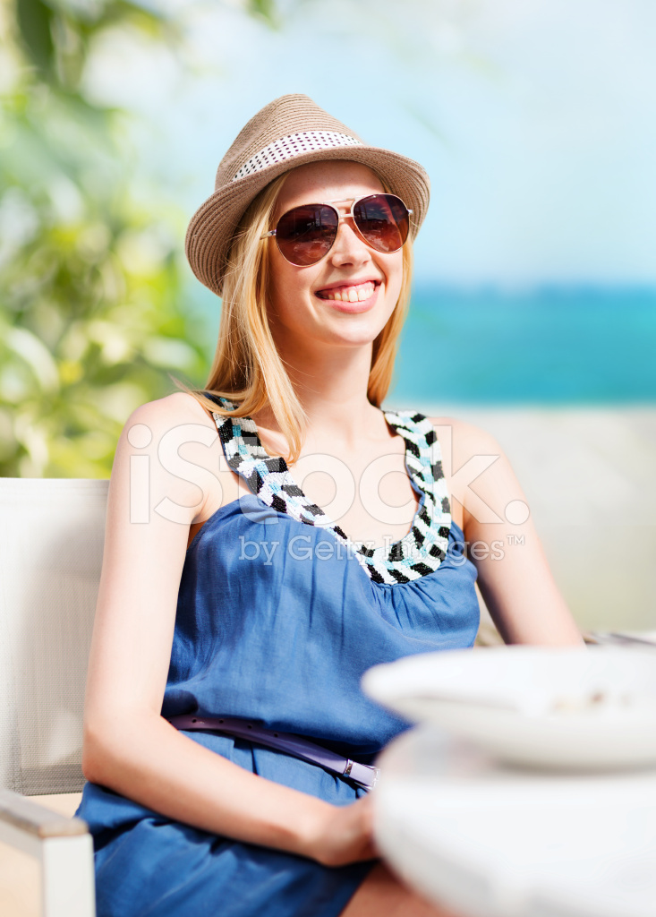 Girl In Shades At Cafe On The Beach Stock Photos