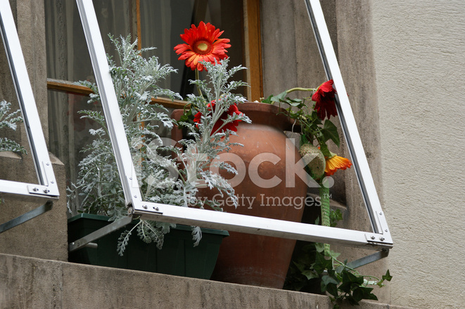 Ceramic Window Sills : Ceramic vase with flowers on the window sill stock photos