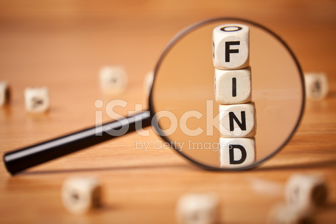 The Word Find Spelled In Letter Cubes Through Magnifying