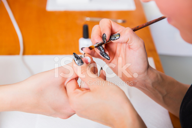 Manicure woman doing nail art stock photos freeimages manicure treatmentautiful woman doing nail art prinsesfo Gallery