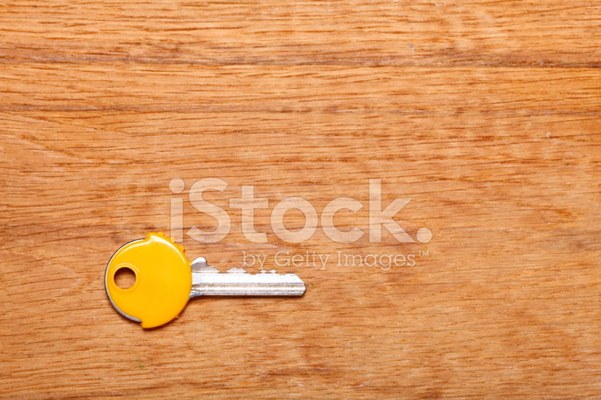 https://images.freeimages.com/images/premium/previews/2917/29171122-house-key-with-yellow-plastic-coats-caps-on-table.jpg