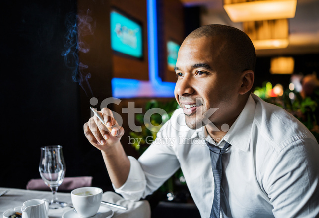 Businessman Smoking Cigar IN A Stock Photos