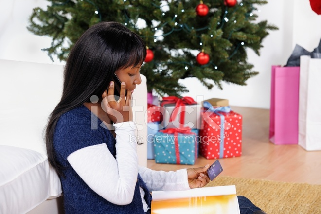 Woman Using A Catalogue And Credit Card For Christmas Shopping Stock Photos Freeimages Com