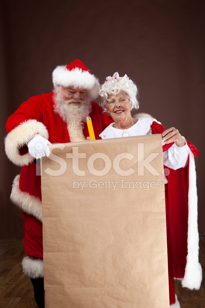 Santa And Mrs Claus Writing On The Naughty Nice List