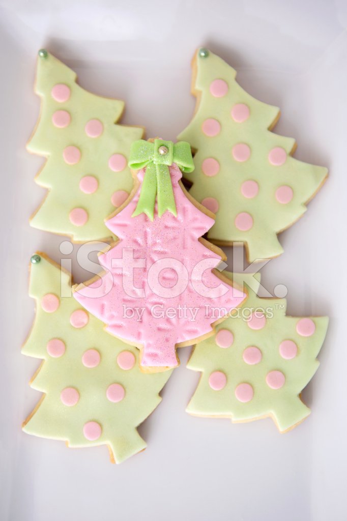 Fancy Pink And Green Christmas Tree Cookies Stock Photos