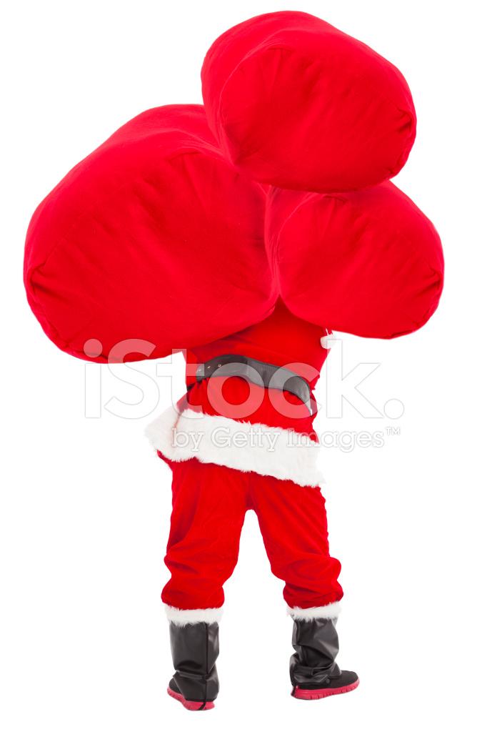 Santa Claus Carrying Heavy Gift Bag Stock Photos