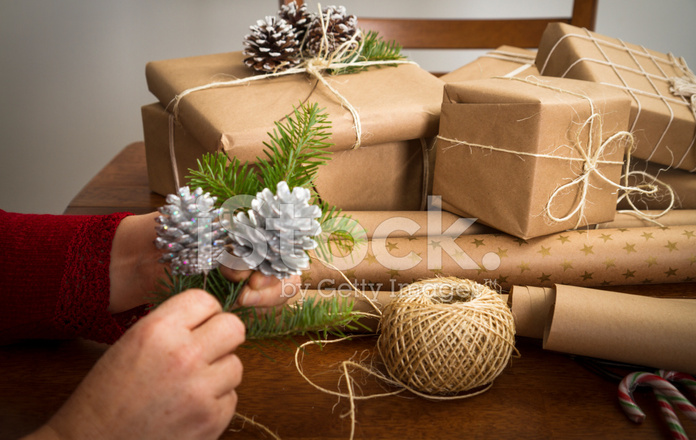 Hands Wrapping Christmas Gifts With Recycled Brown Paper Stock ...