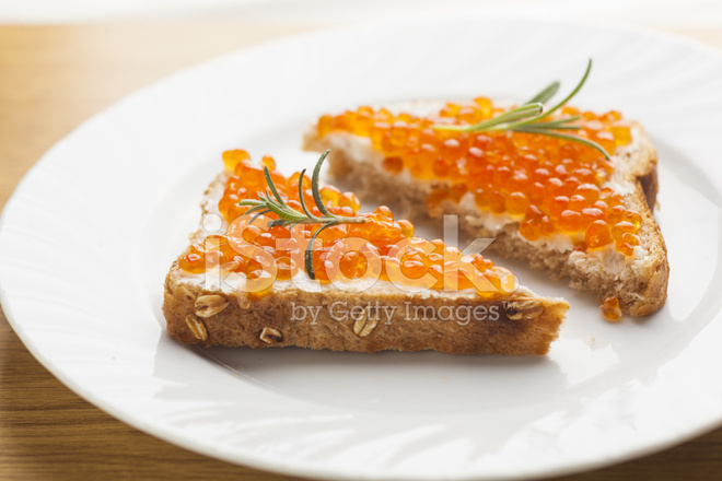 Sendwich with caviar on bread rosemery stock photos for Fish whose eggs are used for caviar crossword