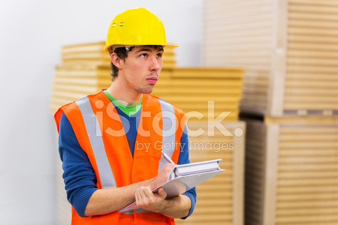 Warehouse worker is checking supplies of insulation material stock warehouse worker is checking supplies of insulation material sciox Choice Image