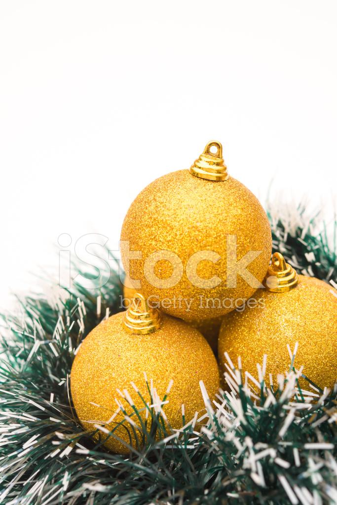 Golden christmas balls on white vertical stock photos