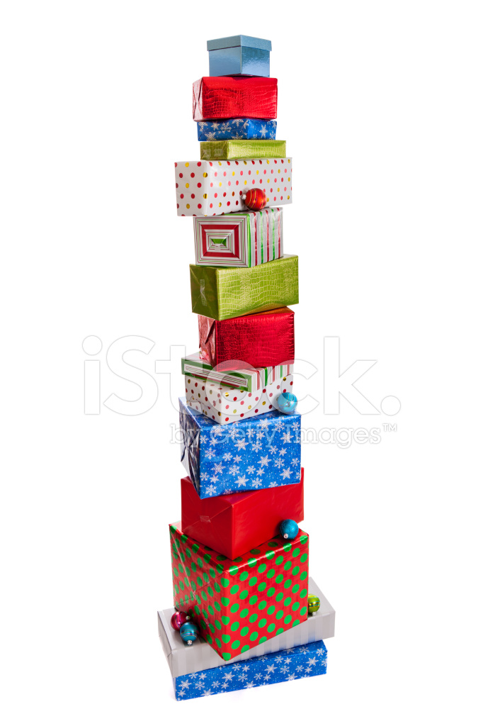 Tall stack of christmas presents isolated on white stock