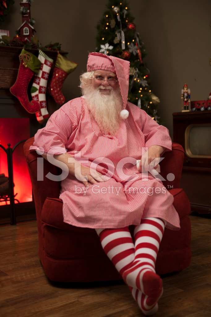 Real Santa IN Pajamas Having Milk and Cookies Stock Photos ... Relaxing Dog Bath