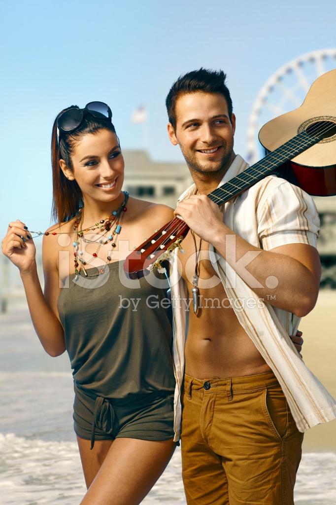 https://images.freeimages.com/images/premium/previews/3127/31276670-happy-loving-couple-walking-on-the-coastline.jpg