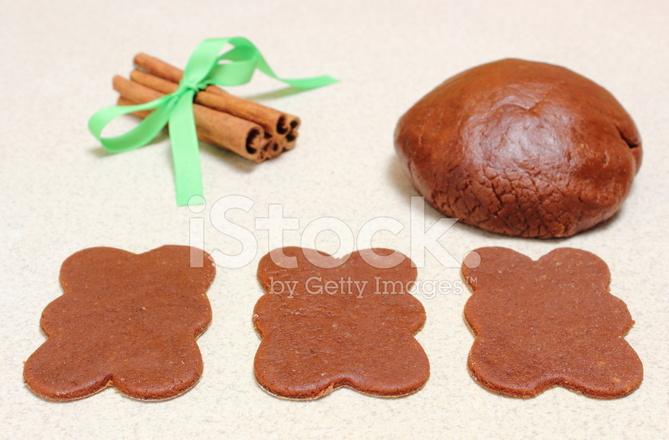 Gingerbread dough for Christmas cookies and cinnamon sticks
