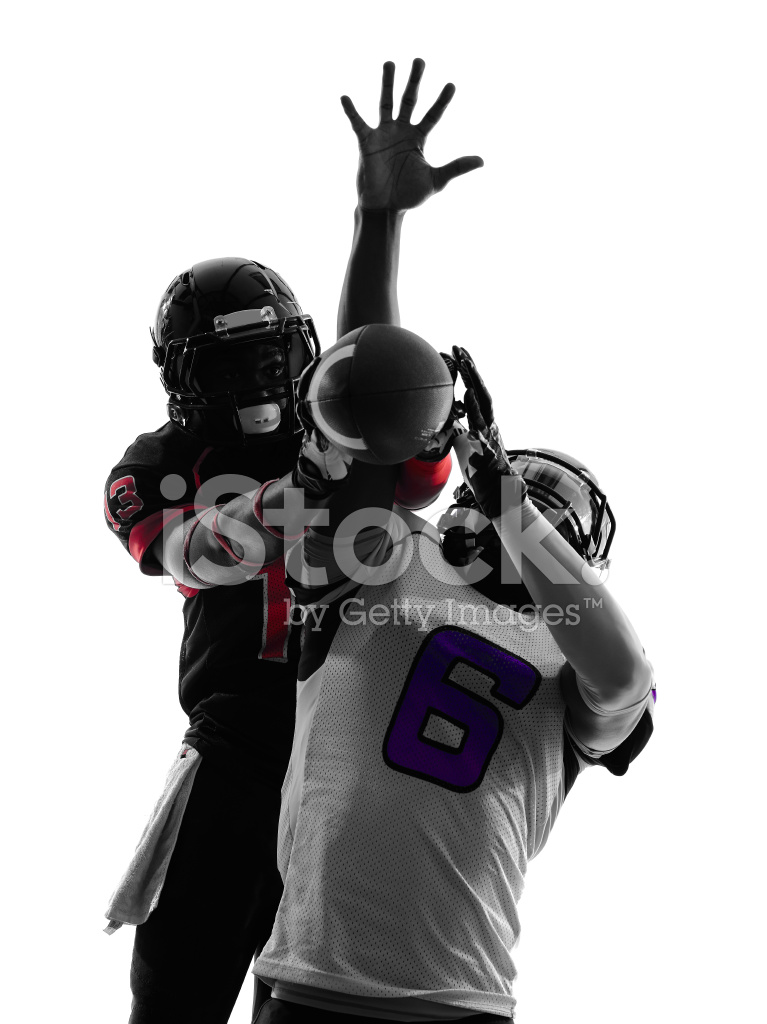 two american football players pass action silhouette stock
