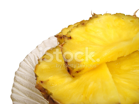 Pieces of Pineapple IN A Dish Over White Background Stock ...
