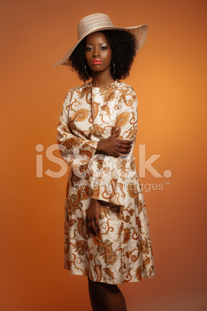 retro 70s fashion afro woman with paisley dress and stock photos