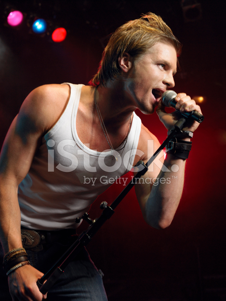 Woman Singing Into Microphone Stock Photos - FreeImages.com