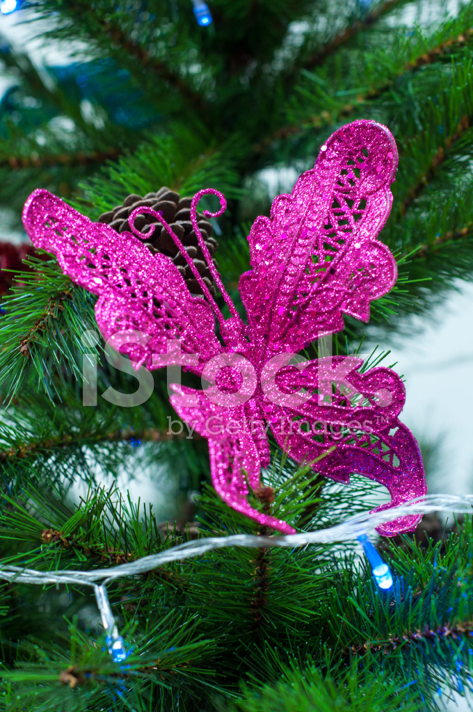 Pink butterfly on christmas pine tree decoration stock photos pink butterfly on christmas pine tree decoration mightylinksfo