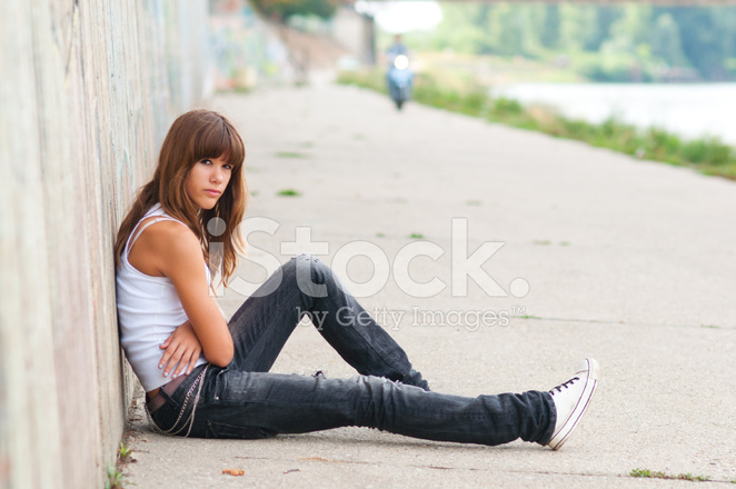 Sad Teenage Girl Sitting Alone stock photos - FreeImages.com