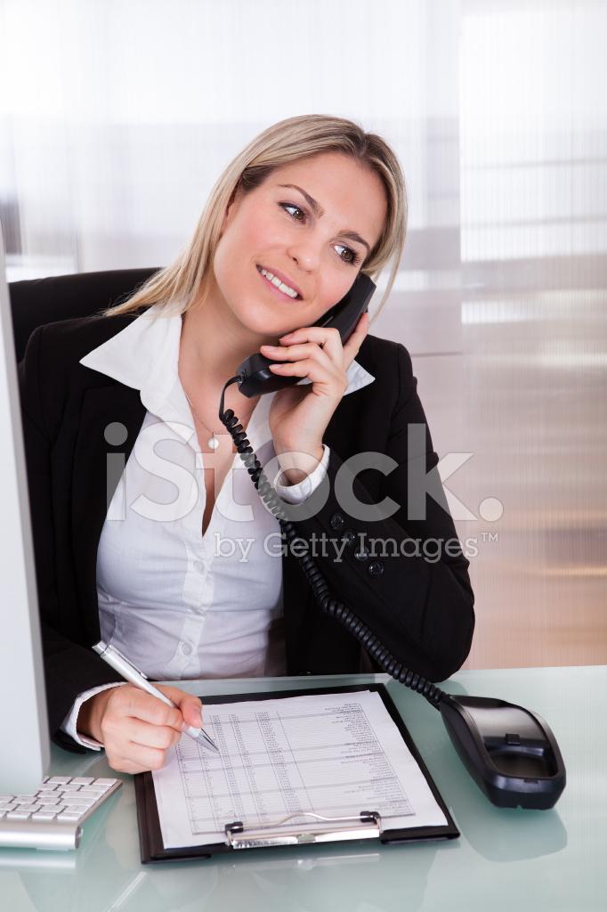 Happy Businesswoman Talking On Telephone Stock Photos
