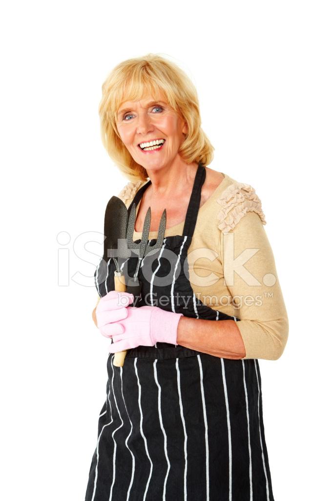Senior Woman Standing In Her Gardening Attire Stock Photos