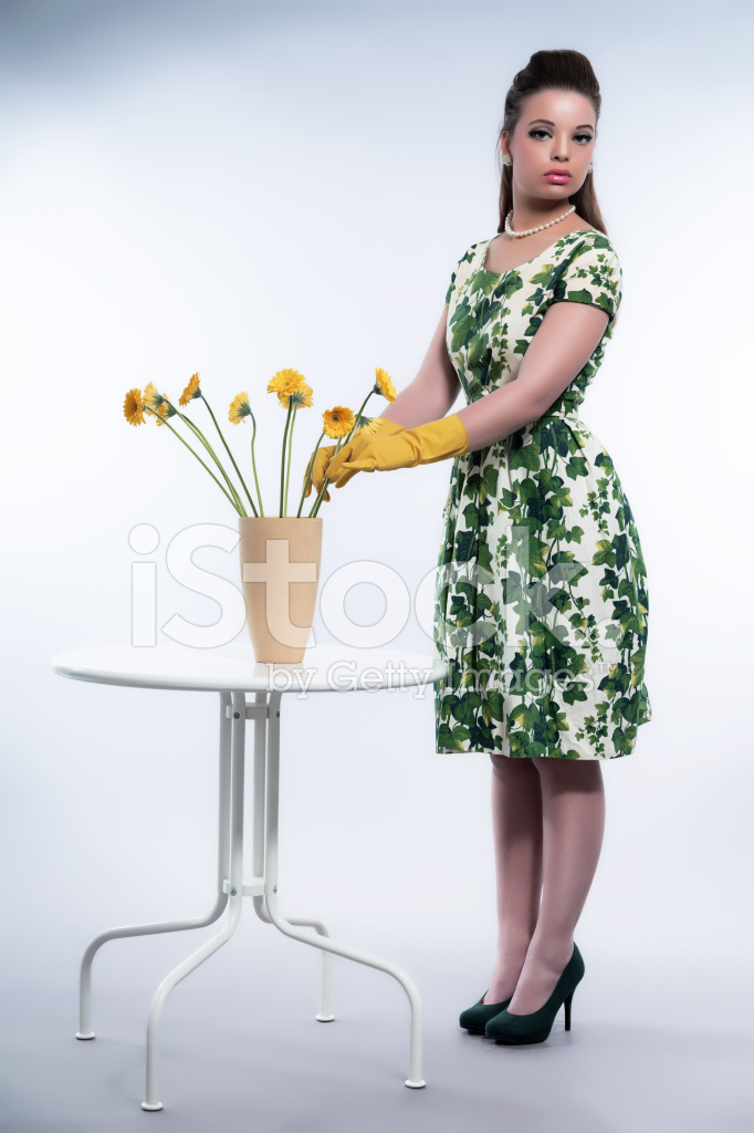 Retro 50s Fashion Housewife Wearing Yellow Rubber Stock