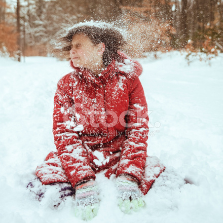 Early Teen Girl Play With Snow In The Winter Forest