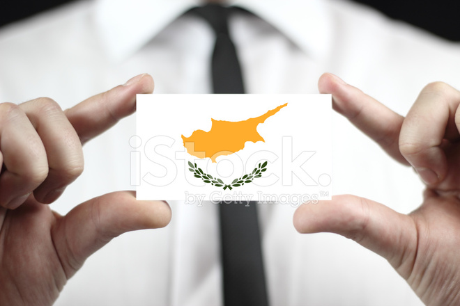 Businessman holding a business card with cyprus flag stock photos businessman holding a business card with cyprus flag reheart Image collections